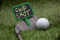 Golf wording term sign with golf ball are on green grass Royalty Free Stock Photo