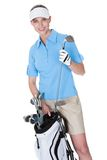 Golfare med en hänga lös av klubbor royaltyfria foton
