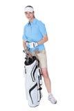 Golfare med en hänga lös av klubbor Arkivbilder