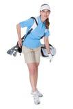 Golfare med en hänga lös av klubbor Arkivbild
