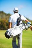 Golfare som går med påsen Arkivbilder