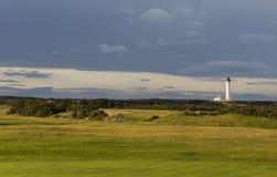 Golfaresikt av den Covesea fyren. Arkivfoton