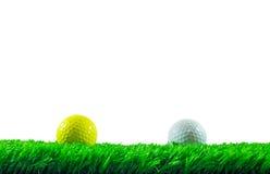 Golfbälle auf Gras Lizenzfreies Stockbild