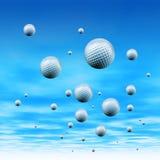 Golfbälle im Himmel Stockfotografie