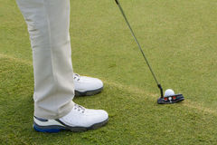 Golfbal en club op green Royalty-vrije Stock Fotografie