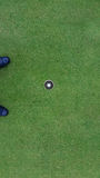 Golfbal en gat royalty-vrije stock afbeelding