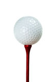 Golfbal en rood T-stuk stock afbeelding