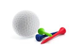 Golfbal en T-stukken Stock Afbeeldingen