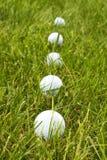 Golfbal Lineup stock afbeelding