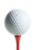 Golfball auf einem T-Stück Stockbild