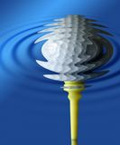 Golfball with blue ripples Stock Photos
