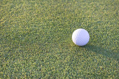 Golfball an der Dämmerung Stockbild