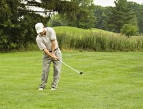 Golfball in der linken Tasche Stockfoto