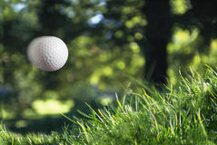 Golfball in flight Royalty Free Stock Photos