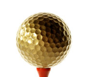 Golfball in gold Royalty Free Stock Photography