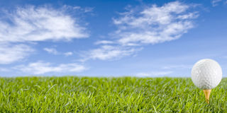 Golfball on the grass. Royalty Free Stock Photo