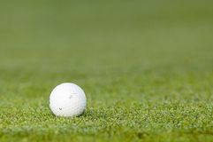 Golfball on a green Royalty Free Stock Photos