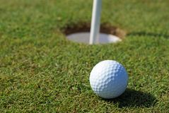 Golfball on green grass Stock Images