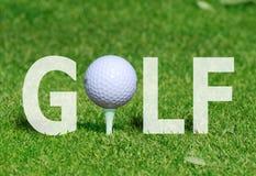Golfball im Wort Stockbild
