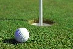 Free Golfball In Front Of The Hole Stock Photo - 5586050