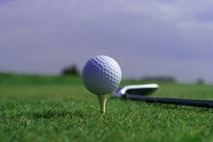 Golfball In Front Of The Hole Royalty Free Stock Image
