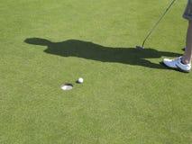 Golfball near hole stock photo