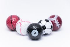 Golfball painted like a ball of many different sports golf ball