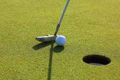 Golfball and putter Stock Images