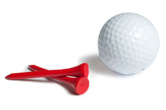 Golfball red tee. Golfball and red tee. white background royalty free stock photos