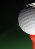 Golfball on red tee Royalty Free Stock Images