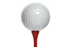 Golfball on red tee. Golfb all on a red wooden tee and white background Stock Images