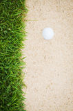 Golfball in sand Stock Images