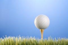 Golfball on a tee Stock Photos