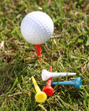 Golfball with tees on grass Royalty Free Stock Images