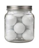 Golfballen in een geïsoleerde Kruik Royalty-vrije Stock Foto's