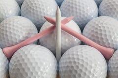 Golfballen en T-stukken Royalty-vrije Stock Foto's