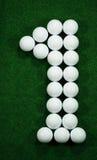Golfballs como número uno Imagenes de archivo