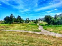 Golfbana i det karibiskt Arkivfoto