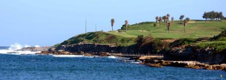 Golfbana på den Malabar stranden Arkivfoton