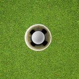 Golfboll i hål Royaltyfri Fotografi