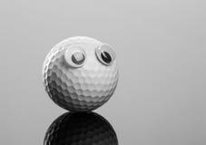 Golfboll med plast- ögon Arkivbilder