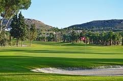 Golfbunker och gräsplan Arkivbilder