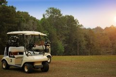 Golfcar in beautiful golf course in the evening golf course with. Sunshine in thailand Stock Photography