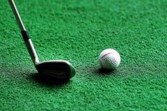 Golfclub en bal Stock Afbeelding