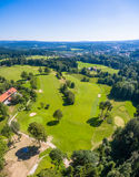 Golfcourse Bavaria Mountains. This is the beautiful Golfcourse close to Bad Tölz Bavaria Germany. This shot was made with a drone out of the sky. Wonderful royalty free stock images