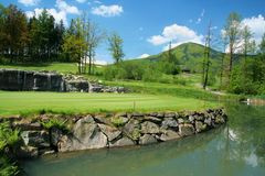 Golfcourse and beauty surroundings with water-jump. Golfcourse and beauty surroundings with small waterfalls stock images