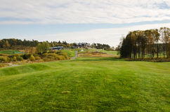 Golfcourse and clubhouse Stock Images