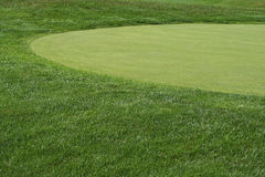 Golfcourse Fairway and Green. The curve of the grass between the fairway and green Royalty Free Stock Image