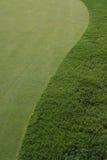 Golfcourse Grün und Fahrrinne Stockbilder