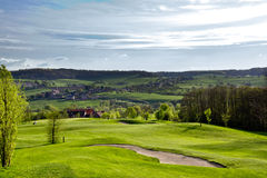 Golfcourse in mountains. Idyllic golfcourse - top view from a hill royalty free stock photography